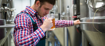 59620395 - brewer smelling beer at brewery factory
